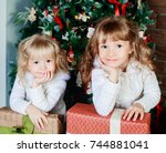 two happy little sisters at... | Shutterstock . vector #744881041
