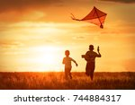 children launch a kite in the... | Shutterstock . vector #744884317