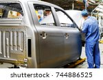 car production line  skilled... | Shutterstock . vector #744886525