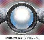 Abstract motive of end of black plastic pipe with blue inside - stock photo
