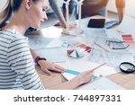 attentive designer drawing... | Shutterstock . vector #744897331