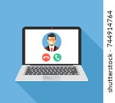 video call on laptop screen.... | Shutterstock .eps vector #744914764