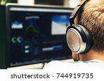 man doing video editing on... | Shutterstock . vector #744919735