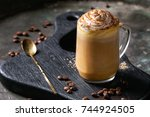 glass of spicy pumpkin latte... | Shutterstock . vector #744924505