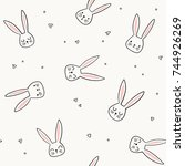Stock vector cute bunny pattern hand drawn rabbit head vector seamless background doodle bunny face and hearts 744926269