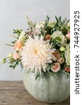 flower arrangement in pumpkin...   Shutterstock . vector #744927925