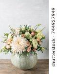 flower arrangement in pumpkin...   Shutterstock . vector #744927949