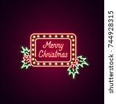 christmas text neon sign. neon... | Shutterstock .eps vector #744928315