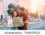 young traveler couple lost in... | Shutterstock . vector #744929521