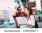young traveler couple lost in... | Shutterstock . vector #744929677