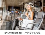young woman in sunhat sitting... | Shutterstock . vector #744944701