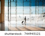view on the aiport window with... | Shutterstock . vector #744945121