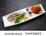 serving square plate with fish... | Shutterstock . vector #744958855