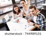 happy friends working and... | Shutterstock . vector #744989131