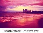 blurred sunset beach in puerto... | Shutterstock . vector #744995599
