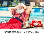 Santa Claus Near The Pool...