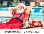 santa claus near the pool... | Shutterstock . vector #744998461