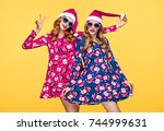 christmas new year. two young... | Shutterstock . vector #744999631