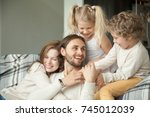 cheerful parents and little... | Shutterstock . vector #745012039