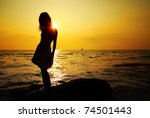Young Woman Standing On Rock I...