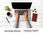 female hands working on modern... | Shutterstock . vector #745017097