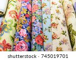 rolls of colored russian fabrics | Shutterstock . vector #745019701