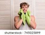 guy with messy hair and... | Shutterstock . vector #745025899