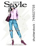 hand drawn fashion woman in... | Shutterstock .eps vector #745027735