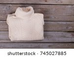 white roll neck sweater folded... | Shutterstock . vector #745027885