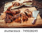 cutting grilled lamb on wooden... | Shutterstock . vector #745028245