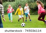happy children are jogning and... | Shutterstock . vector #745036114