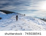 man is backpacking in winter... | Shutterstock . vector #745038541