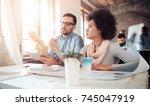business team sitting in office ... | Shutterstock . vector #745047919