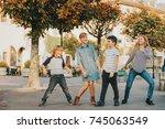 outdoor portrait of 4 fashion... | Shutterstock . vector #745063549