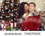 happy couple in christmas... | Shutterstock . vector #745070545