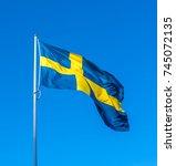 swedish flag blue sky... | Shutterstock . vector #745072135