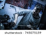 a person is fixing a part of an ... | Shutterstock . vector #745075159