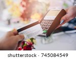 man paying for flowers with his ... | Shutterstock . vector #745084549