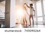 romantic couple at home.... | Shutterstock . vector #745090264