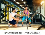 fitness woman in training doing ... | Shutterstock . vector #745092514