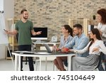 team of young professionals... | Shutterstock . vector #745104649