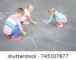 cute little children drawing... | Shutterstock . vector #745107877