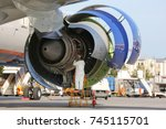 Stock photo technician checking engine of civil airliner 745115701