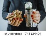 woman hands with an iron jar...   Shutterstock . vector #745124404