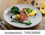 plate with delicious grilled... | Shutterstock . vector #745133005