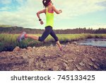 trail runner woman running on... | Shutterstock . vector #745133425