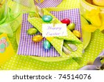 easter table decoration in green,violet and yellow colors - stock photo