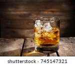whiskey on wood background | Shutterstock . vector #745147321