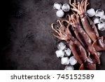 fresh raw whole squid on a dark ...   Shutterstock . vector #745152589