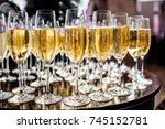full cold champagne flutes... | Shutterstock . vector #745152781
